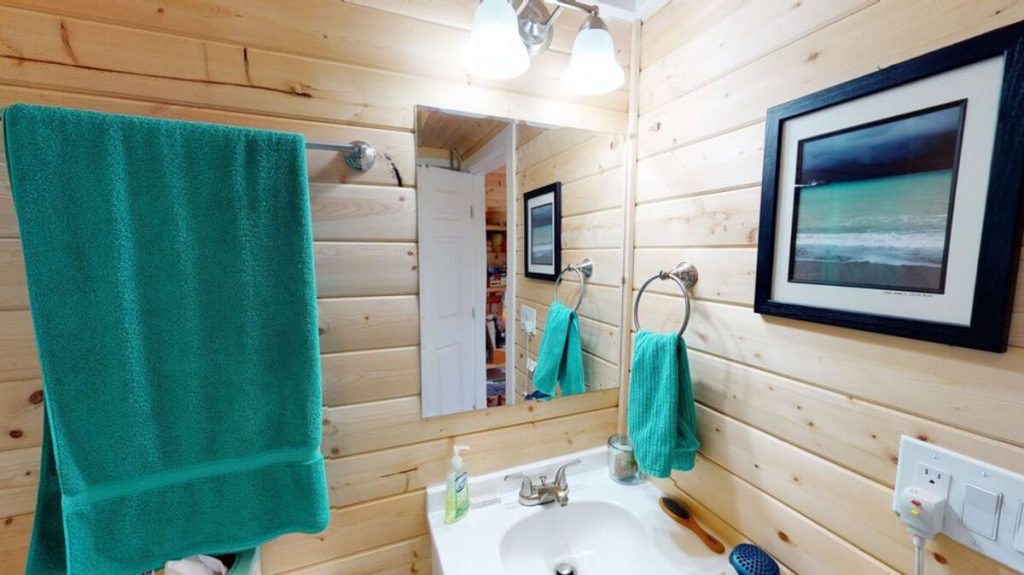 Tiny house bathroom with teal accents