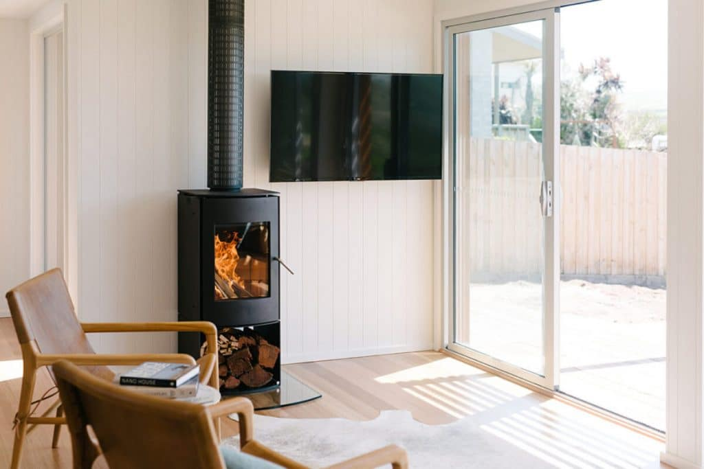 Wood fireplace by TV