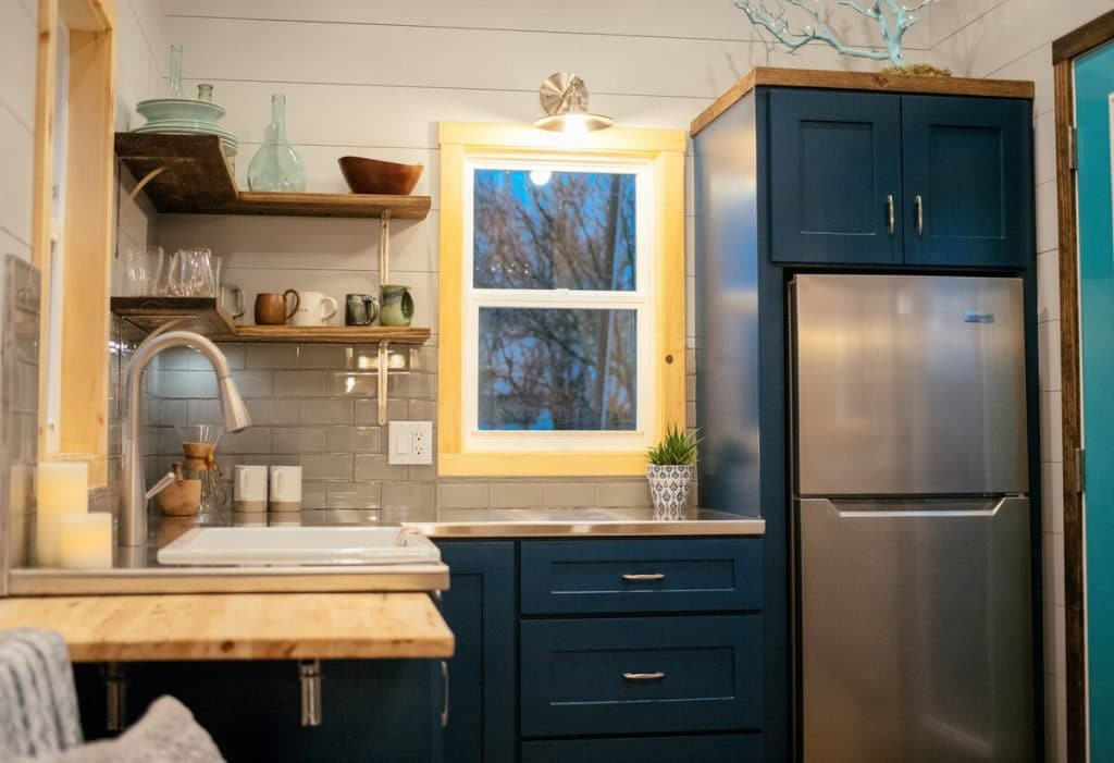 Lykke tiny house teal cabinets in kitchen