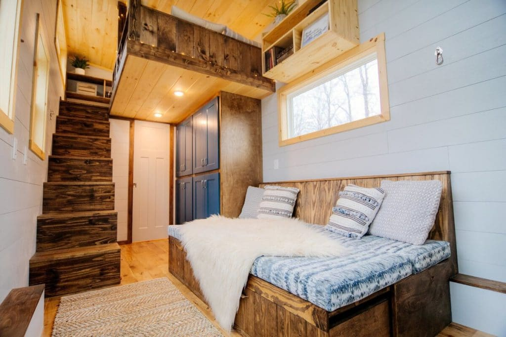 Rustic couch in Lykke tiny house