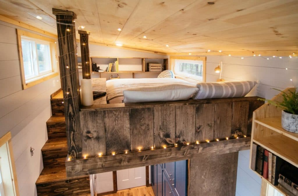 Lights on loft bed in tiny house