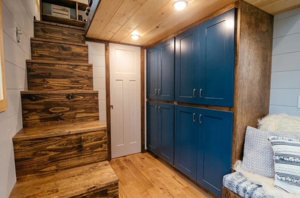 Tall teal cabinets in tiny house
