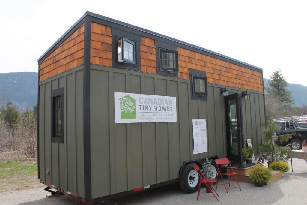 Monarch green tiny house with cedar siding