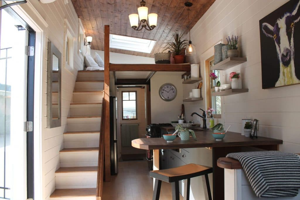 Living room with loft stairs