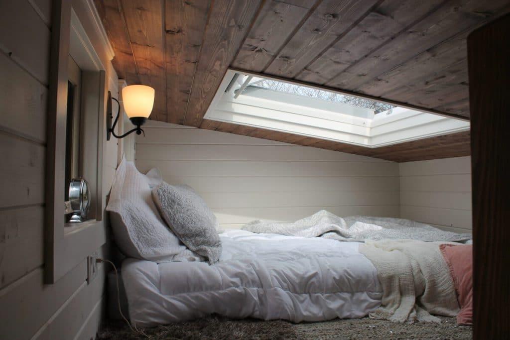 Bed in loft by sunlight