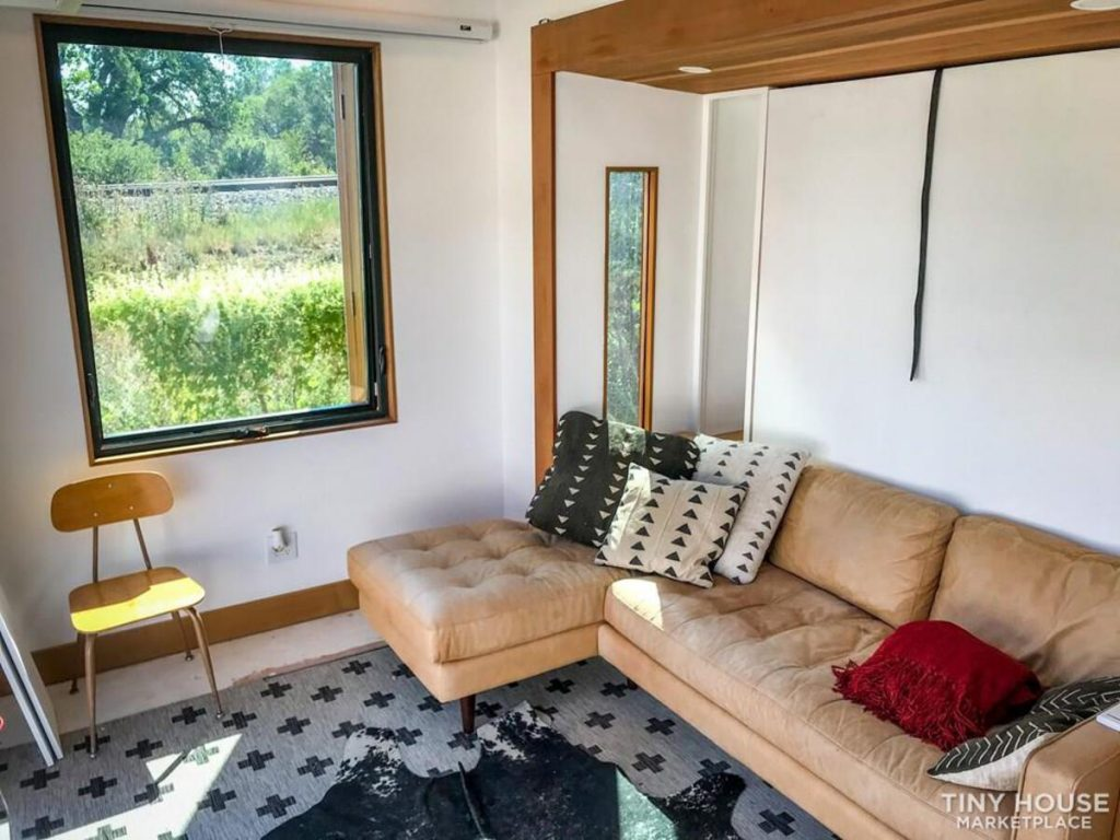Window open in tiny house living room