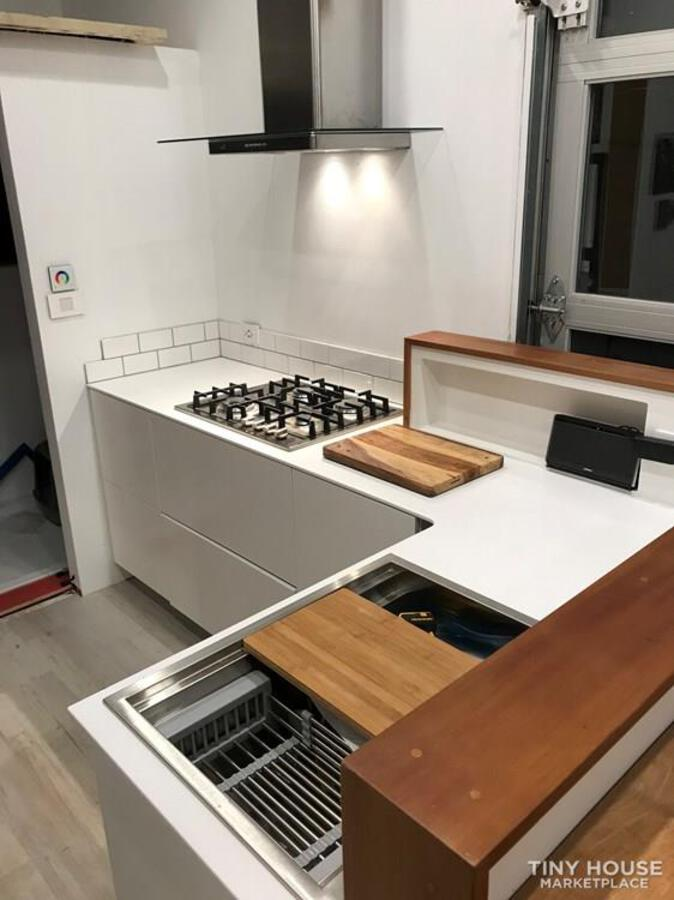 Kitchen top with stove in tiny house