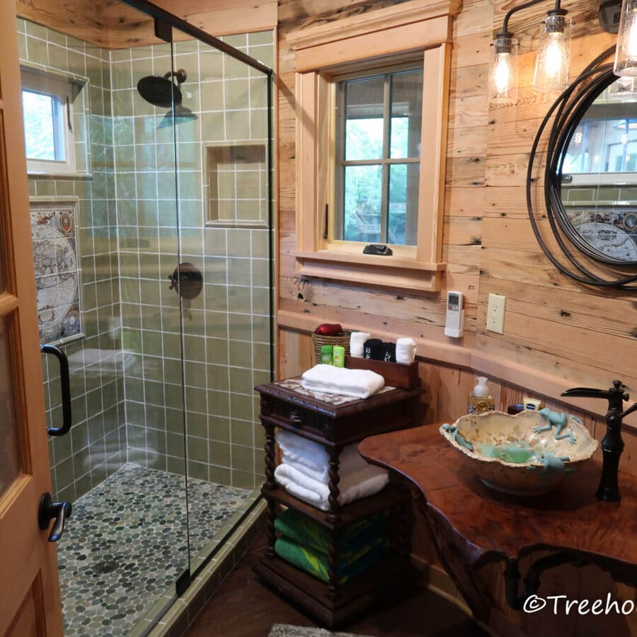 Treehouse bathroom with tile shower