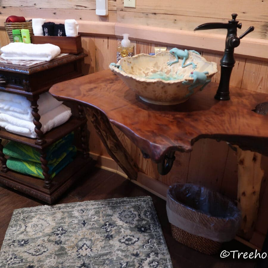 Bowl sink on wooden shelf