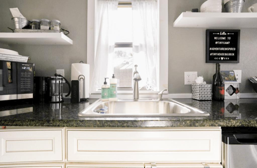 Kitchen sink with white cabinet