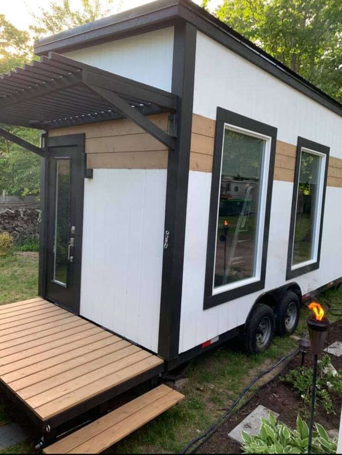 White and brown tiny house with porch