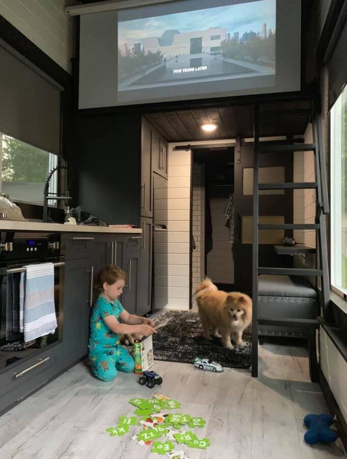 Kid and dog playing in living room