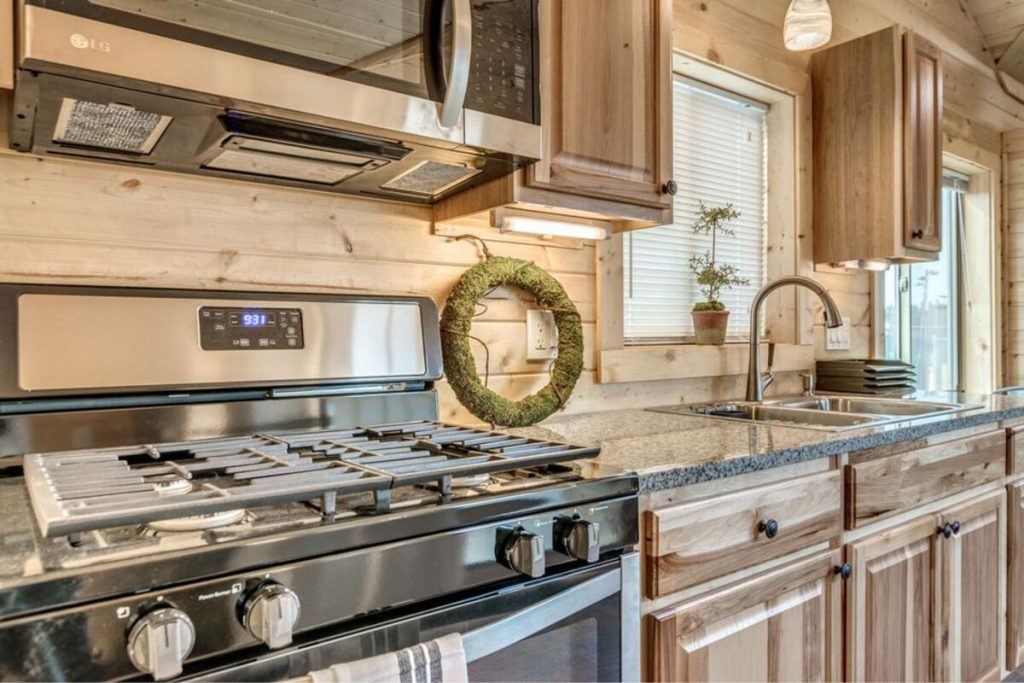 Large stove in tiny house kitchen