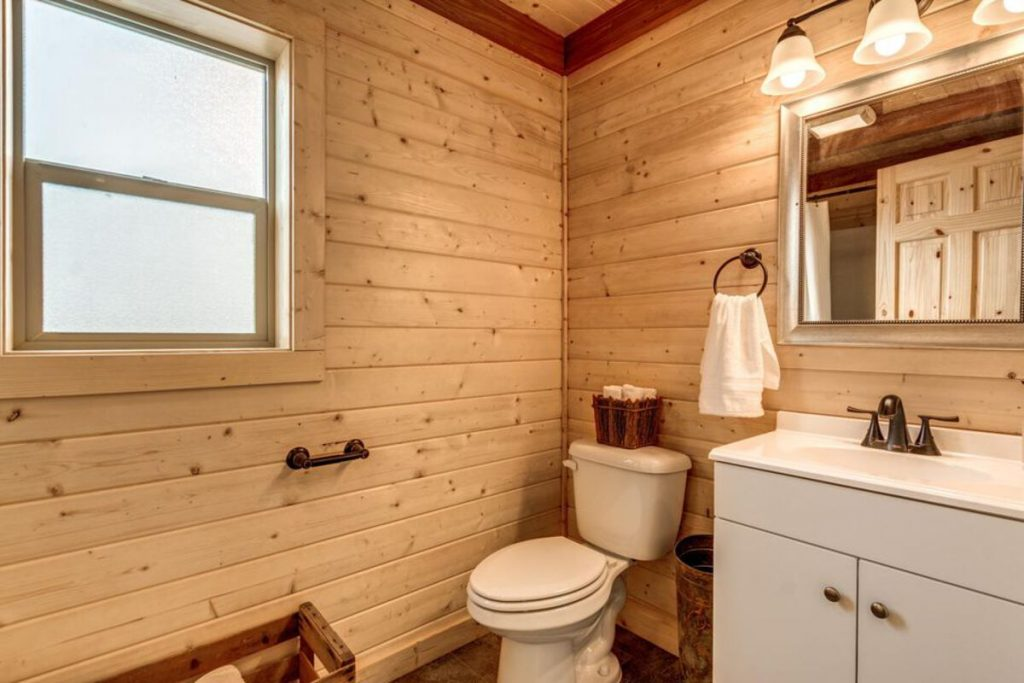 Tiny house bathroom with vanity and wooden walls