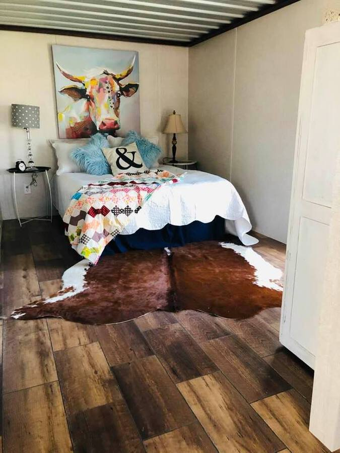 Bed with animal rug