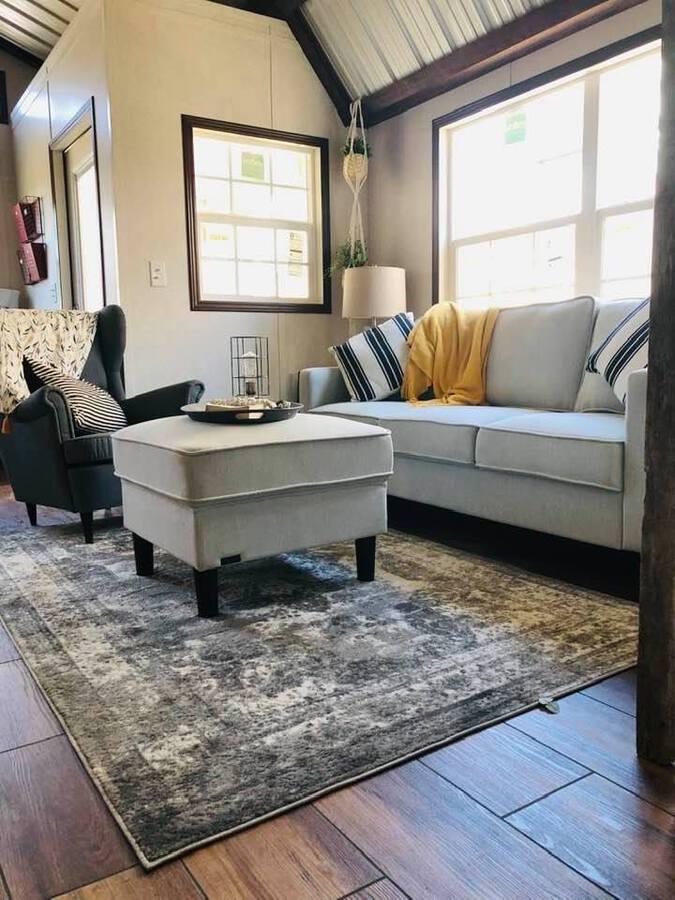 Grey sofa and ottomon in living area