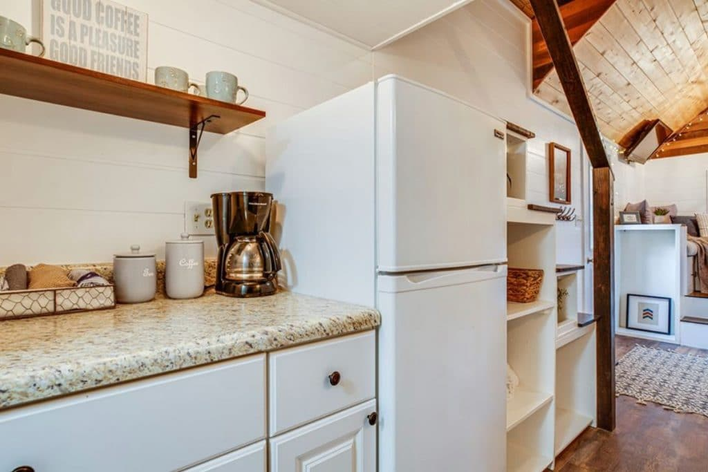 White refrigerator and cabinets