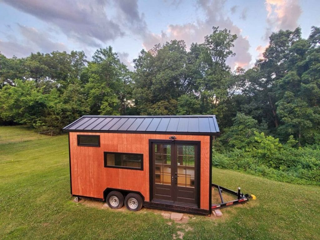 Woodworkers dream tiny house in field