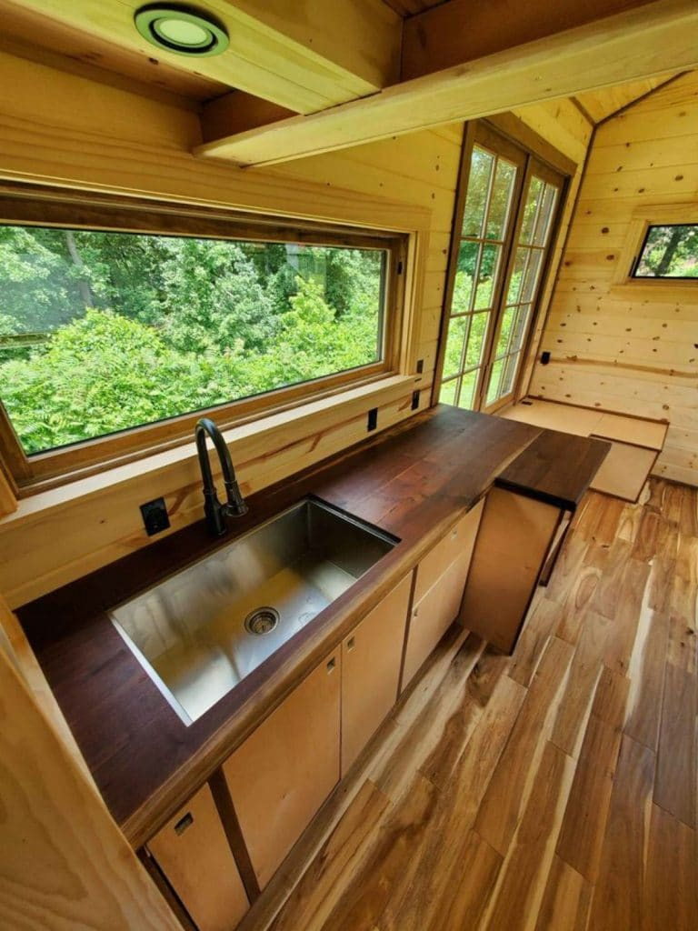 Sink in stained wood kitchen