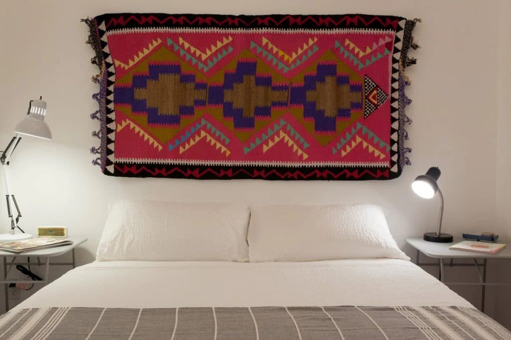 Tapestry above tiny house bed