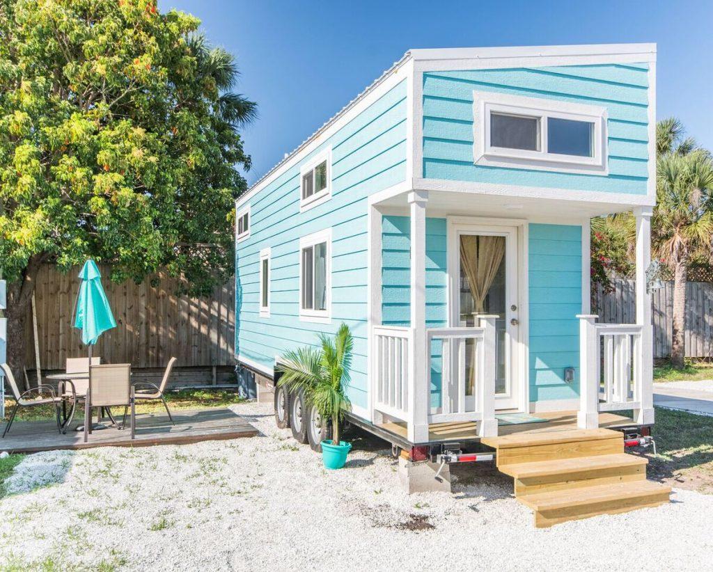 Teal tiny house on beach