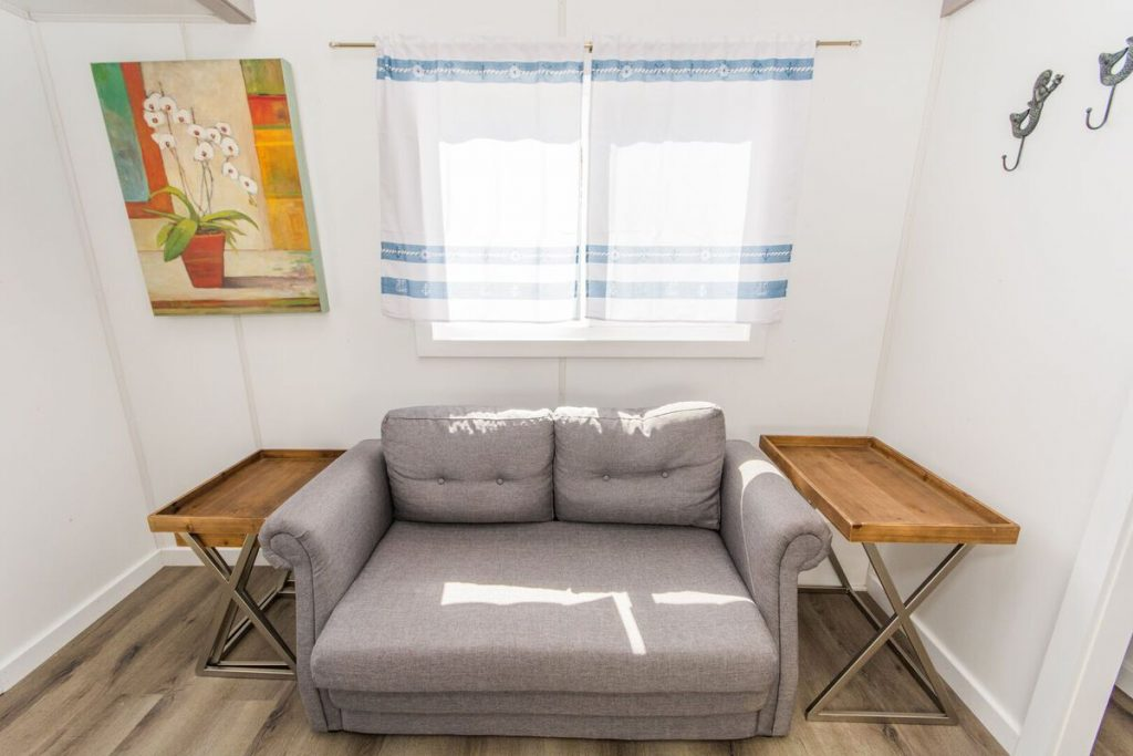 Grey sofa with tv trays on each side