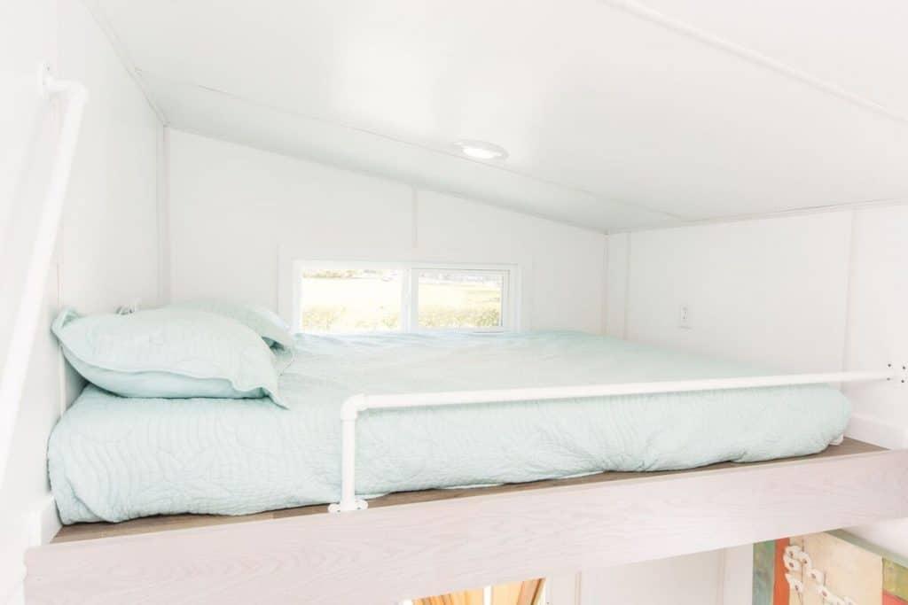 Loft bedroom with aqua bedding