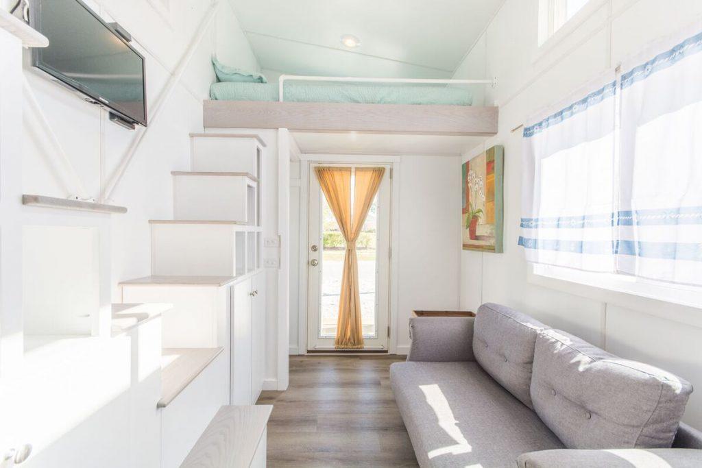 Grey sofa by steps to loft