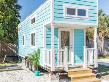 Teal tiny house on beach