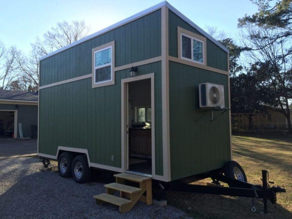Door open on green tiny house