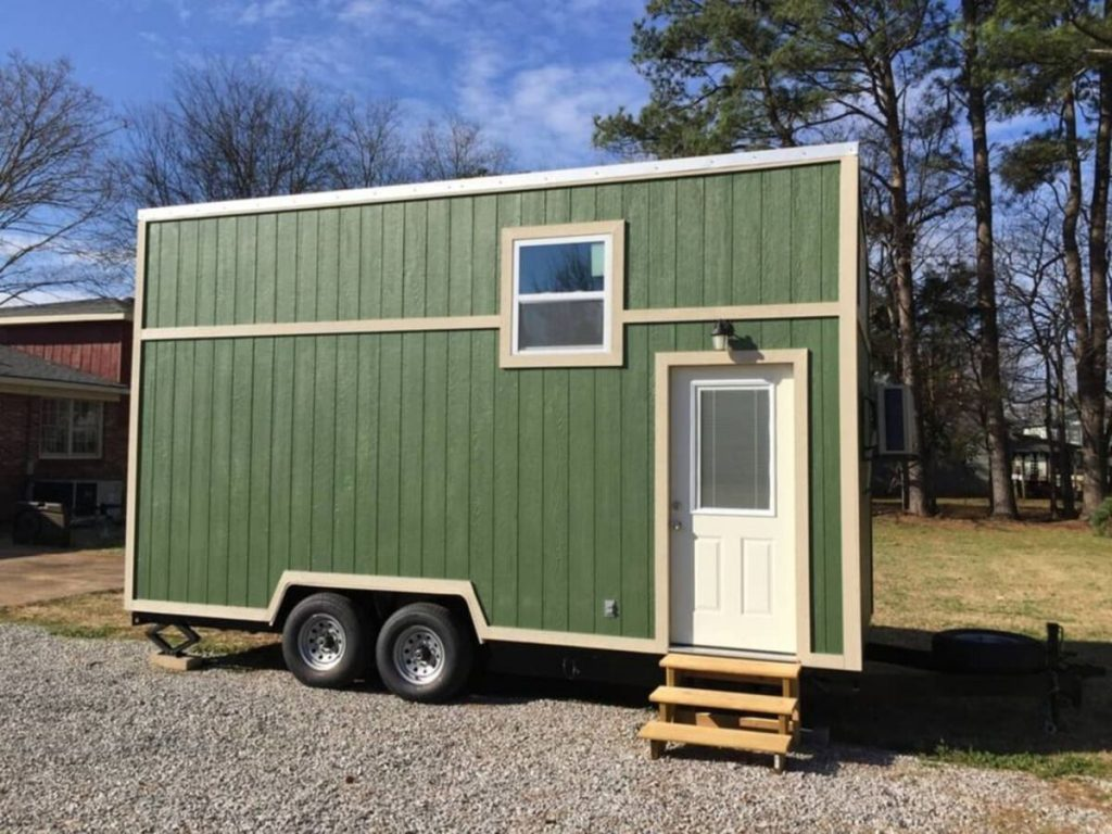 Green tiny house with white door