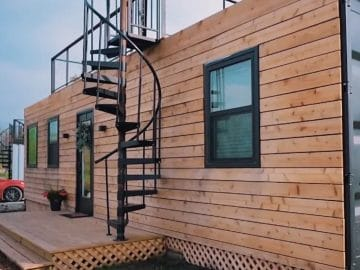 Rustic tiny home with spiral staircase