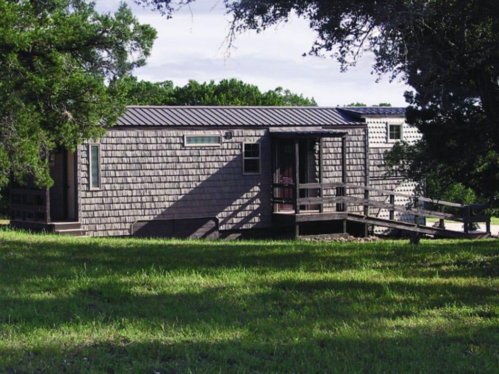 Tiny house on grassy knoll