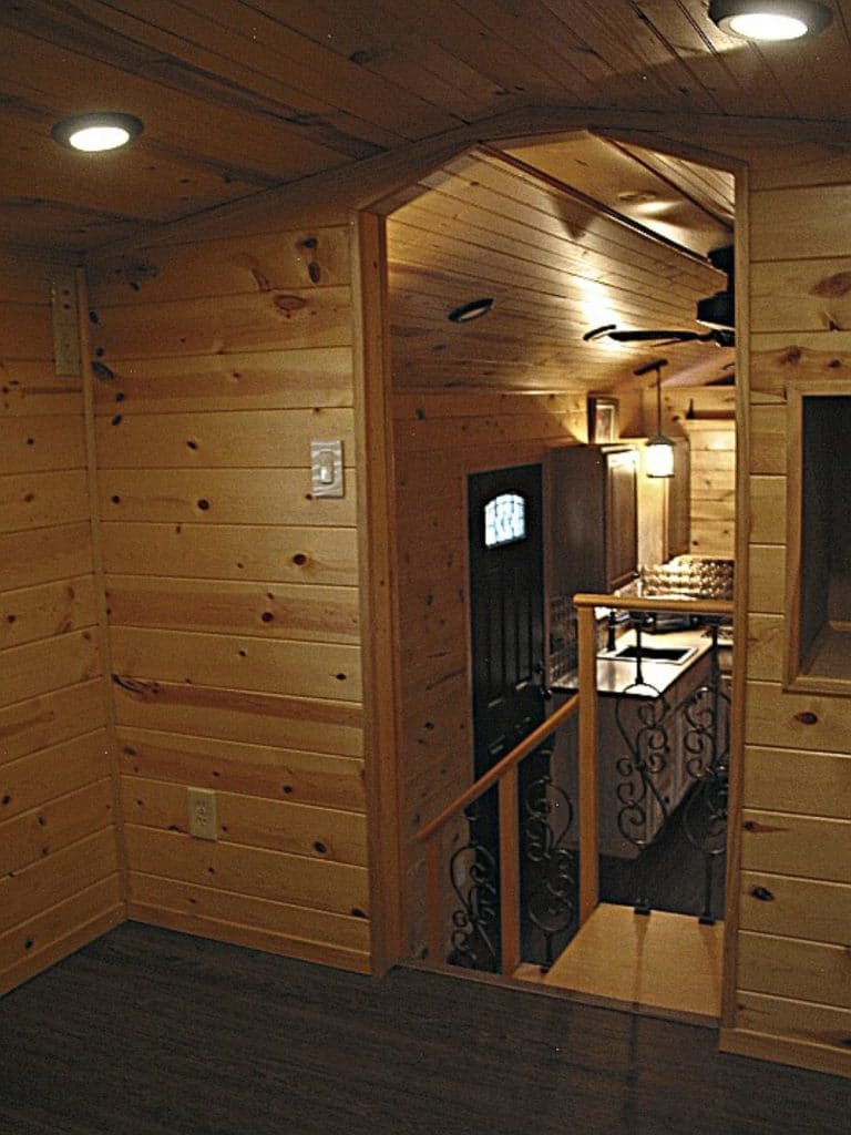 Loft bedroom with wood paneling