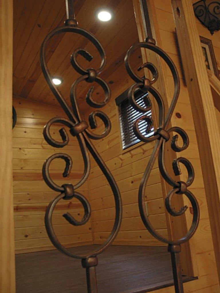 Wrought iron accent on railing