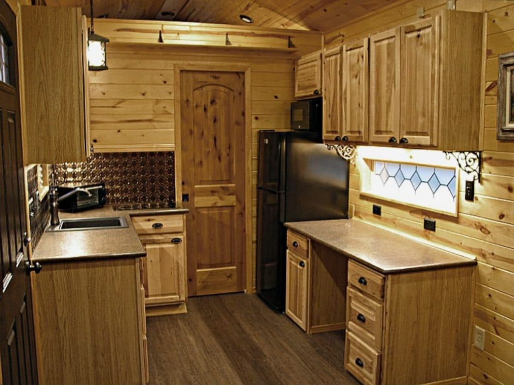 Tiny house kitchen with black appliances