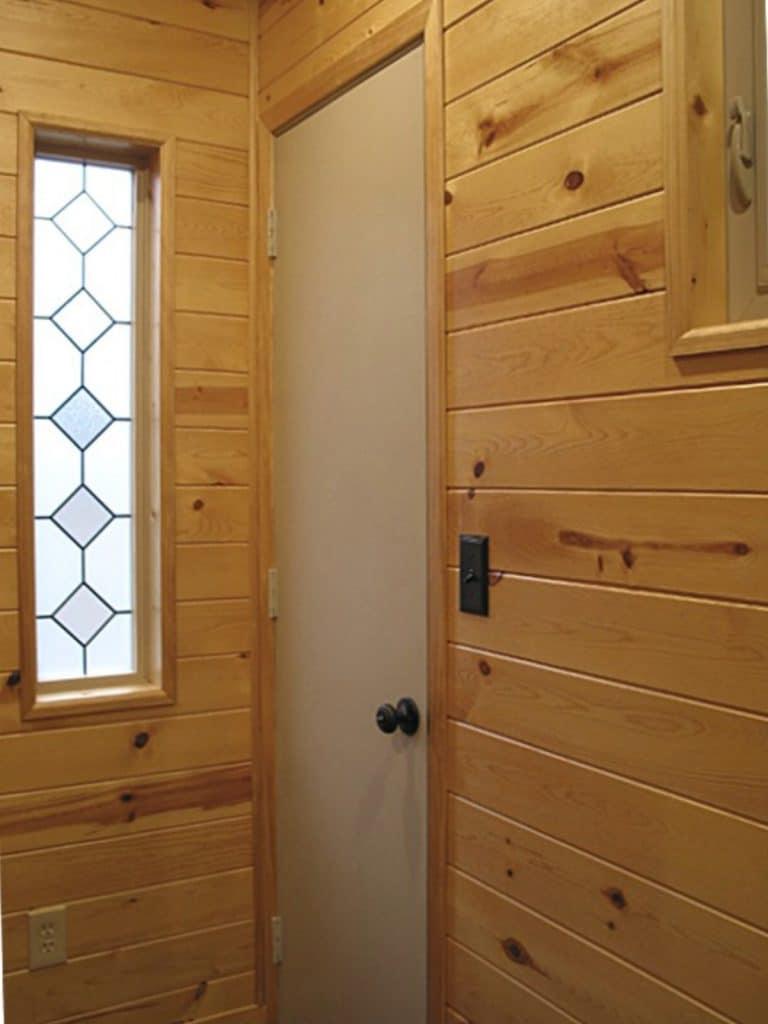 Front door by ornate window