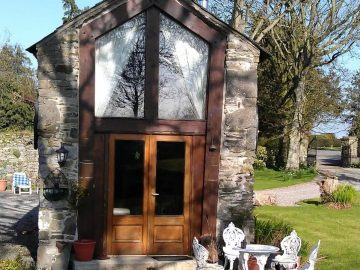 Front door to stone cottage tiny houseI'