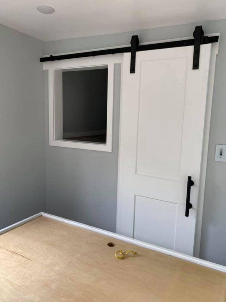 Door to tiny bedroom
