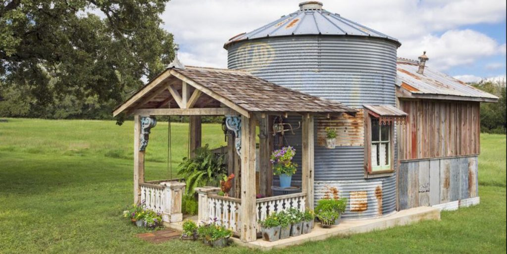 Grain silo tiny house with porch
