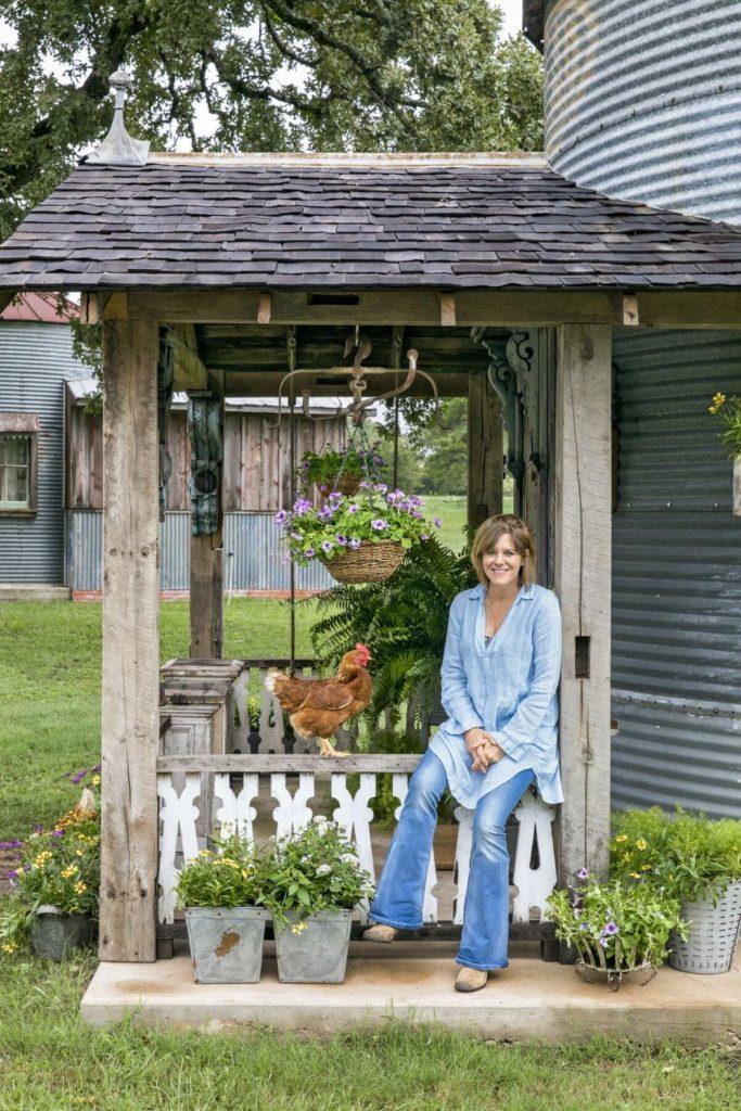 Woman sitting on porch of grain silo