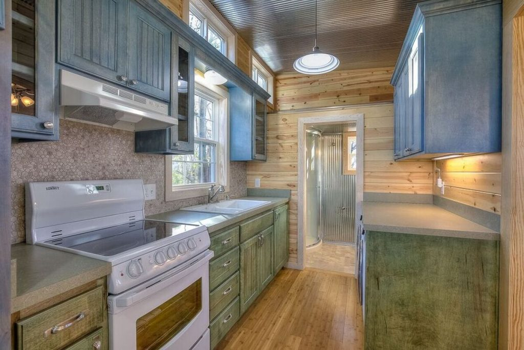 Kitchen with weathered teal cabinets