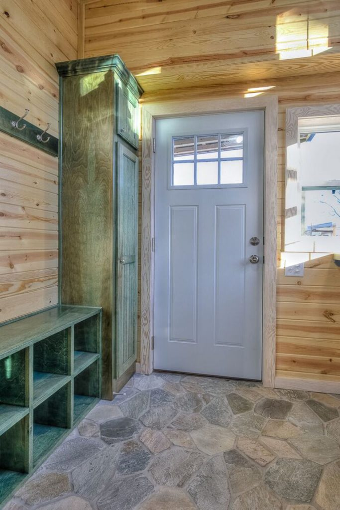 Entry to tiny home with shoe storage