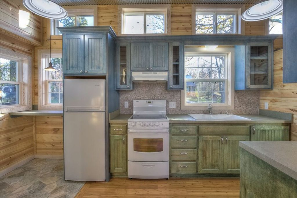Kitchen with weathered teal cabients