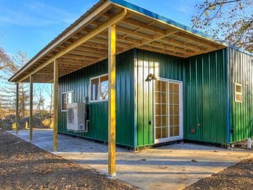 Green shipping container tiny house