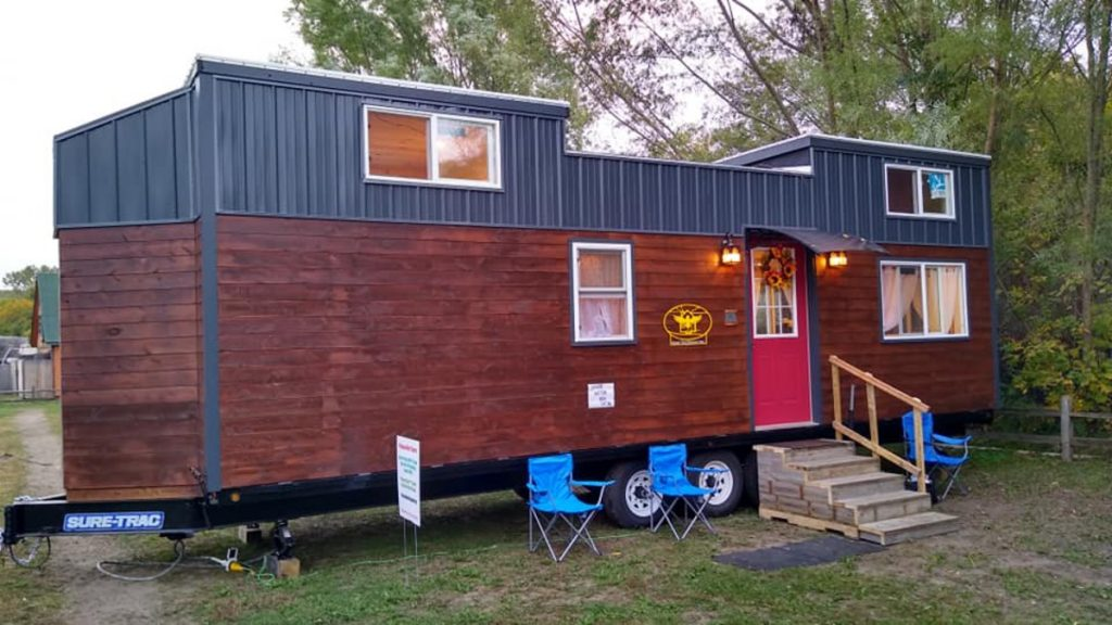 Marroon and blue tiny home on wheels