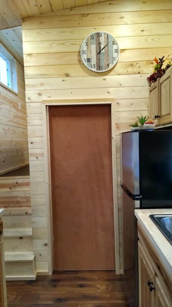 Door to bathroom in tiny house