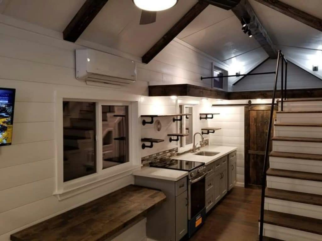 Tiny house kitchen with wooden bar