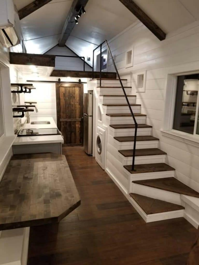 Stairs to loft with wood floor