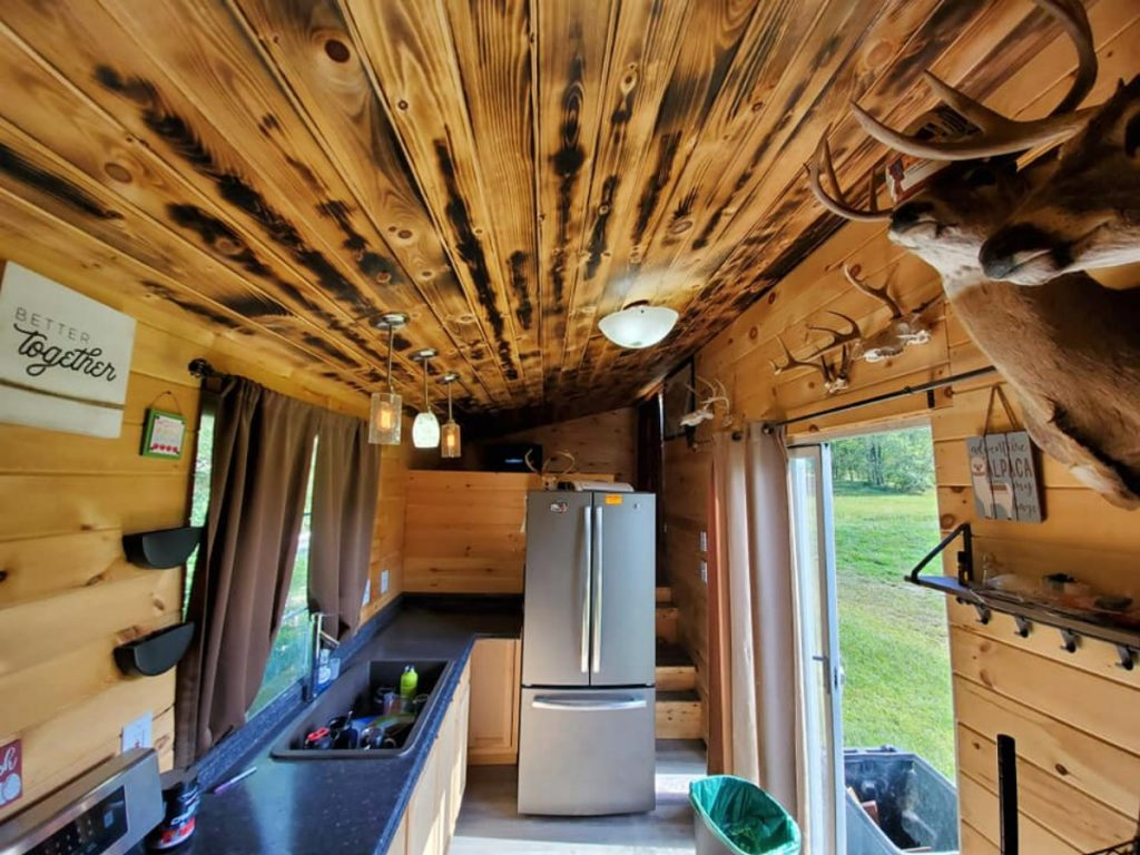 Rustic tiny house cabin with refrigerator